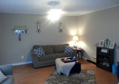 Living room of Broadway Apartments in Auburn, AL